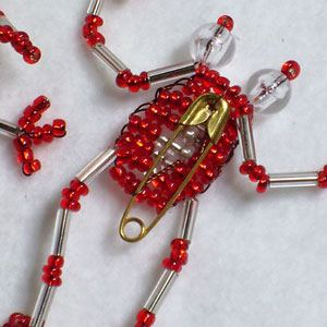 Very cute beaded frog silver/red